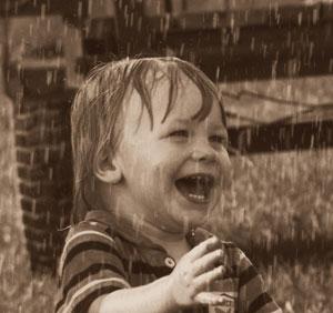 happy toddler in the rain